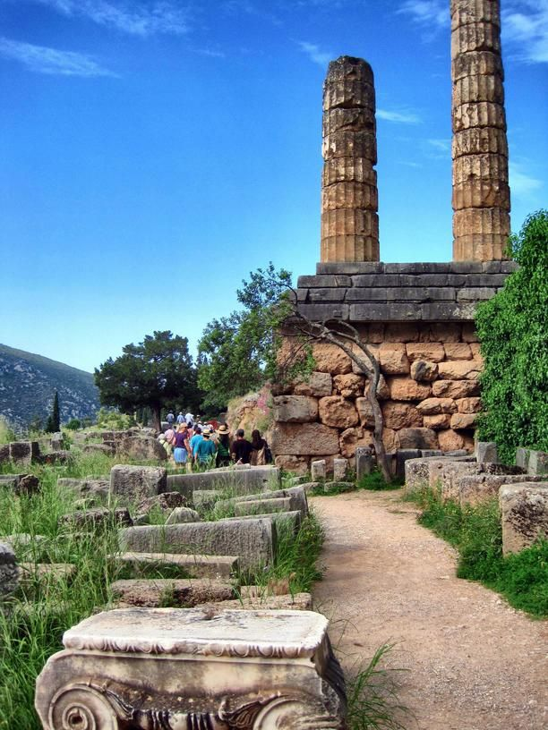Temple of Apollo at Delphi, Phocis, Greece — by Travel Ginger. Site of the ancient Oracle of Delphi #wanderlust #Greece
