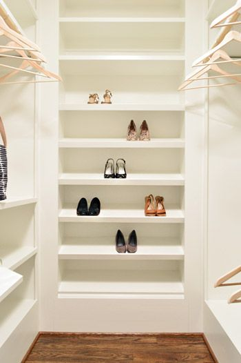 Dream shoe area of angled shelves in a Young House Love designed show home http://www.younghouselove.com