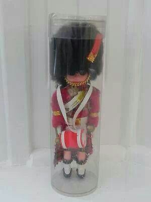 Those national costume dolls that came in the plastic containers.