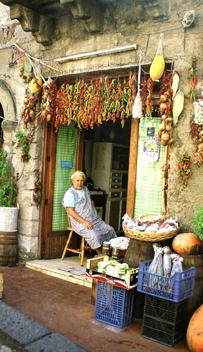 Typical Sicilian street scene.  The Sicilians consider the sidewalk as part of their personal property! ~Saucy