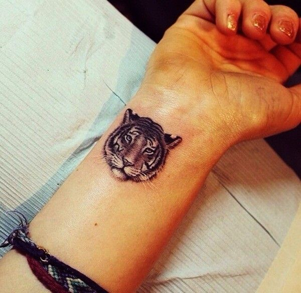 60 Best Wrist Tattoos Meanings Ideas And Designs 2016 Tiger Face Tattoo Small Wrist Tattoos Wrist Tattoos For Guys