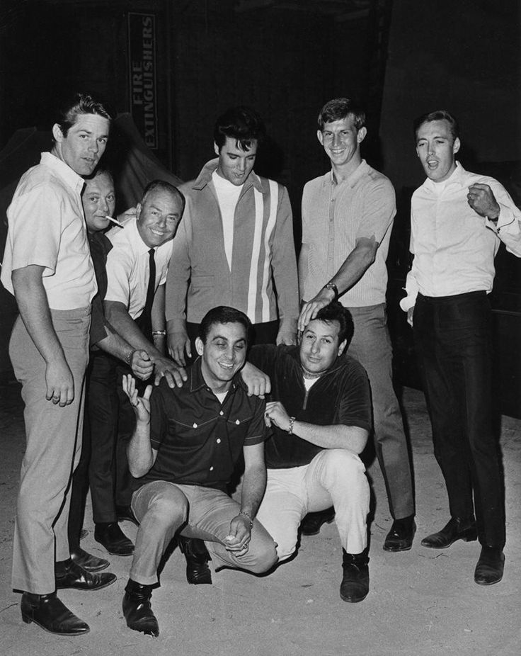 "On the set of ""Speedway"" From left to right: Standing: Jerry Schilling, Marty Lacker, Larry Jost (sound depertment), Elvis, Don Sutton (Pitcher LA Dodgers), Richerd Davis. Sitting: George Klein, Diamond Joe Esposito"