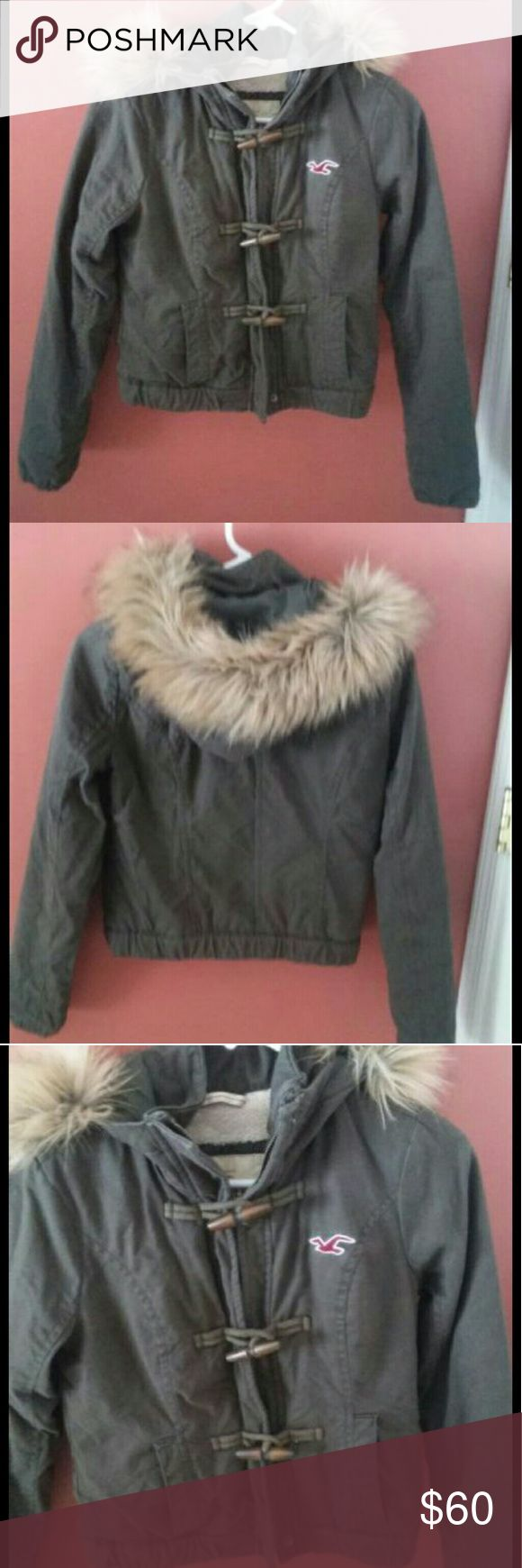 Girls Hollister coat Girls Hollister coat, size XL but is very small. Only worn once, in very good condition and kept clean. Hollister Jackets & Coats