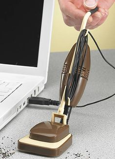 "Messy desk? Well, this tiny retro-designed USB Desk Vacuum ($13.49) can't help with the big stuff, but it can definitely help keep your workstation crumb-free! Just plug it into a free USB port and vacuum up those crumbs... and yes, the mini-vacuum handle tilts back, just like the real one. Cool, as in ""clean."""