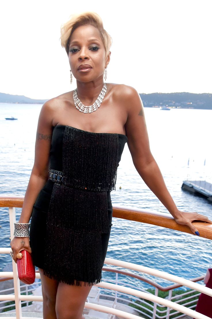 Mary J Blige on a yacht in the Cote d'Azur sea bay for Cannes, living the luxury lifestyle. Wearing a classic LBD with black fringing and a red clutch, and a diamond necklace and bracelet cuff with earrings by Avakian. For glamour celebrity fashion Cannes Film Festival red carpet jewellery spotting travel here: http://www.thejewelleryeditor.com/jewellery/top-5/best-red-carpet-jewellery-jewelry-cannes-film-festival-2017-weekend/ #jewelry