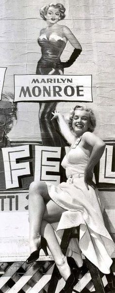 YOU'RE AS YOUNG AS YOU FEEL - Marilyn Monroe checks out the billboard promoting her name and the movie.