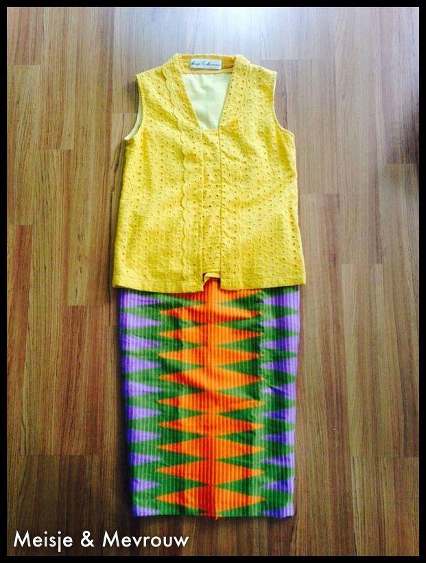 Kutu baru in turmeric and rang rang woven skirt