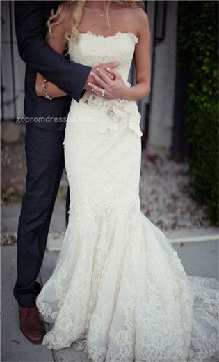 absolutely in love with this dress. Now about that groom thing? :)