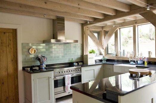 Shaker style kitchen in oak frame house