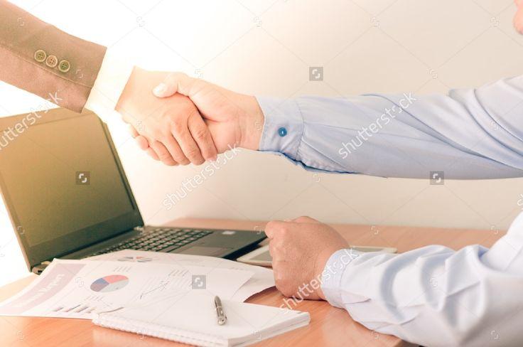 Businessman working on office desk. Businessman is handshake for communications . Blurred background, Vintage concept. #business #businessman #man #professional #office #background #notebook