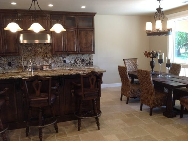 Kitchen with Dark Wood Cabinets & Versailles Travertine Floors at Palo Cedro Oaks Subdivision PCOaks.com