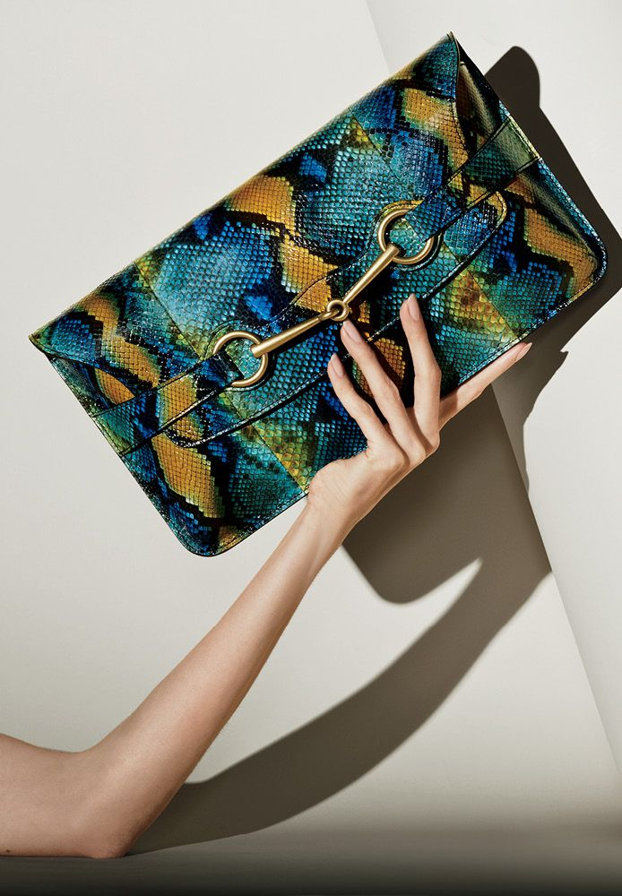 Oversized and chic this flap closure clutch is the carry-all alternative for an evening out. #gucci