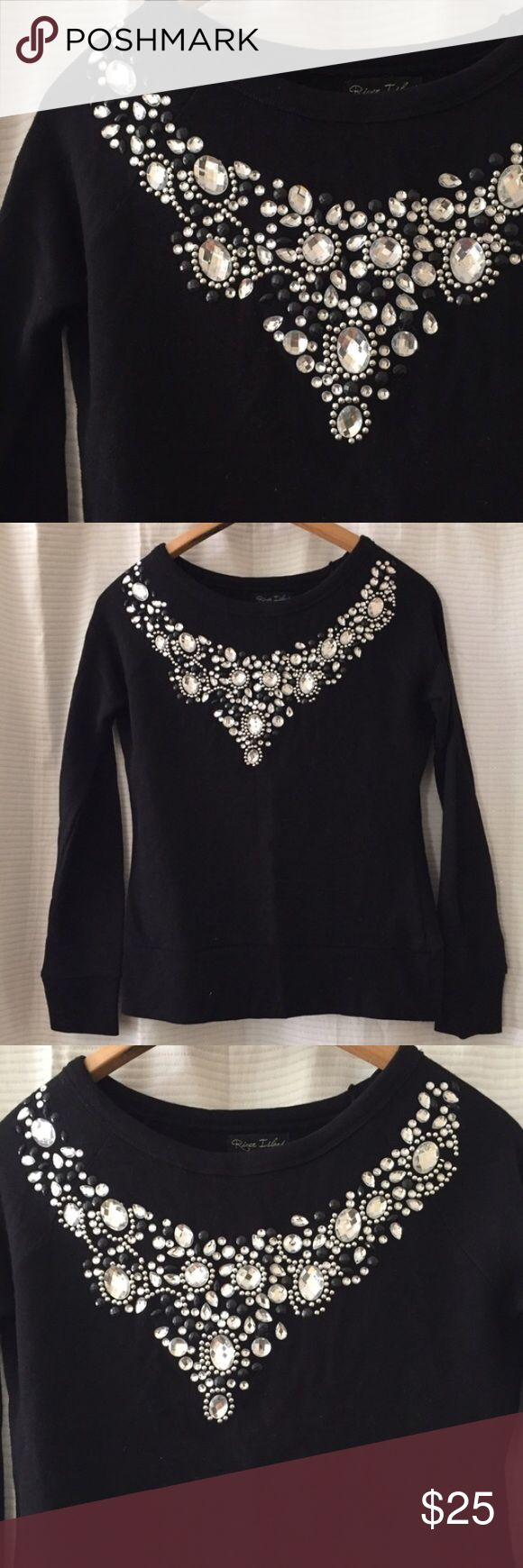 River Island Jeweled Sweatshirt/Top River Island brand jeweled sweatshirt/top (has what feels like sweatshirt material on the inside). Super comfortable, but looks dressy because of the bejeweled collar. Only worn a handful of times. Size XS. River Island Tops