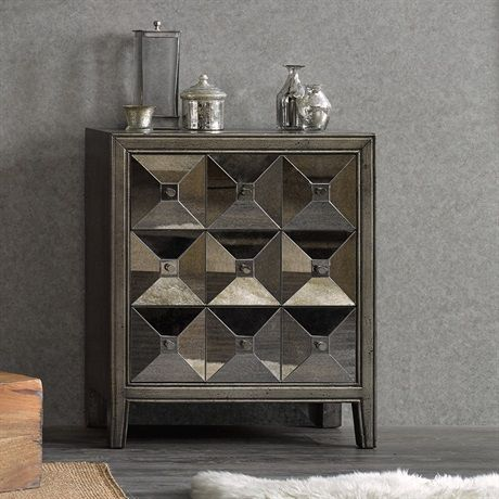 The contemporary lines to this dimensional antiqued mirror chest with its faux apothecary styling and classic hardware give this piece definite timeless appeal.