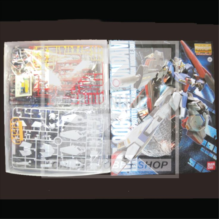 [MODEL-KIT] MG 1/100 - MSZ-006 - ZETA GUNDAM VER 2.0. Item Size / Weight: 39 x 31 x 10.6 cm / 806g*. (*ITEM SIZE & WEIGHT BEFORE PACKAGED). Condition: MINT / NEW & SEALED RUNNER. Made by BANDAI.
