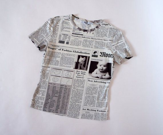 Hello Im glad youre here VINTAGE PANDORA shop I offer vintage MOSCHINO JEANS blouse newspaper print Made in Italy 92 % poliamid 8% elastam