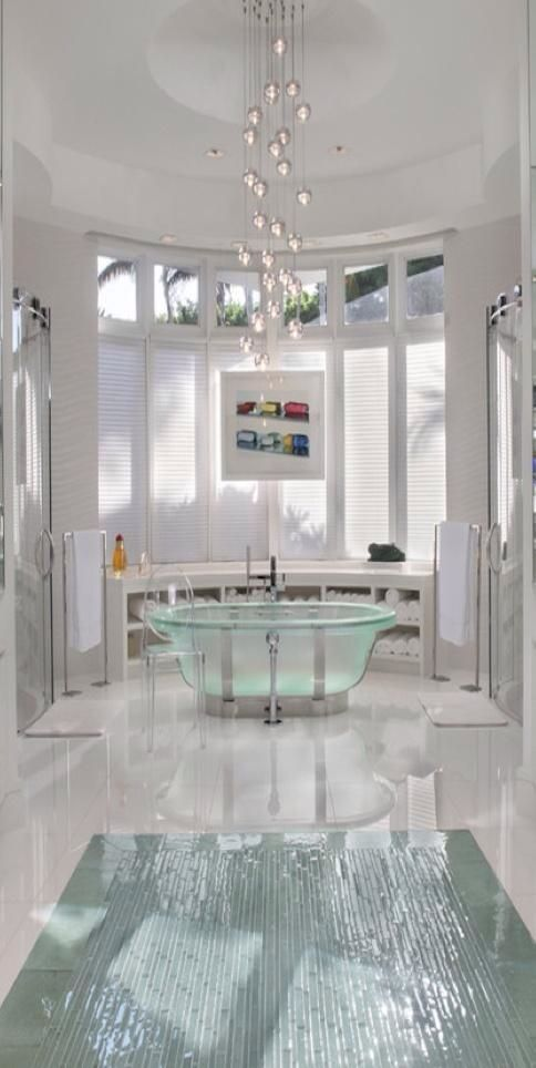 http://rbctile.com/series/vetro/     Create a luxury spa #bathroom with neutral towels, peaceful #plumbing accessories and gorgeous window view.