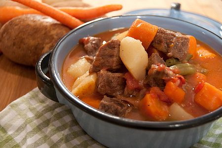pressure cooker beef stew- 1 1/2 lbs. beef stew meat  3 tblsp. oil  2 large potatoes  4-5 large carrots  1 large onion  1 can green beans with liquid  2 cans diced tomatoes with liquid  Salt  Pepper  2 tblsp. cornstarch  1/3 cup cold water