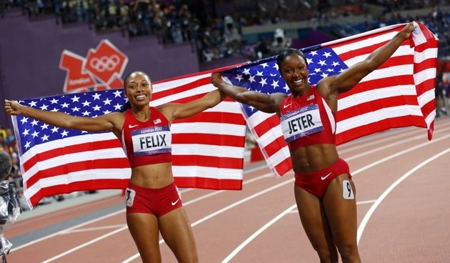 Allyson Felix of the U.S. celebrates winning the women's 200m final with third place finisher and compatriot Carmelita Jeter (R) during the London 2012 Olympic Games at the Olympic Stadium August 8, 2012. REUTERS/Kai Pfaffenbach (BRITAIN - Tags: SPORT ATHLETICS OLYMPICS TPX IMAGES OF THE DAY)