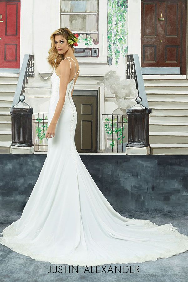 25781caca4e8 Modern embroidered lace crepe fit and flare wedding gown with dual  spaghetti straps.