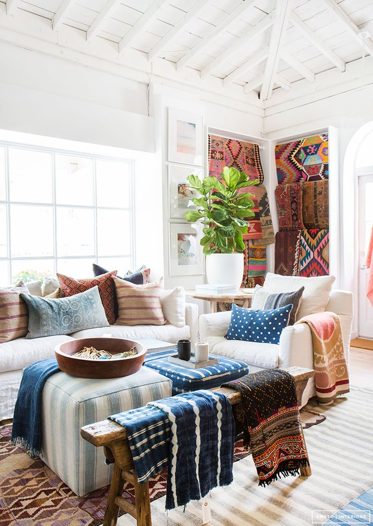 The different patterns of the blankets and pillows make the space feel more eclectic.