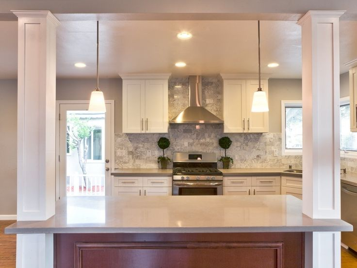 "Contemporary Kitchen with Hardwood floors, Columns, Dynasty Hardware European 6.75"" Bar Pull, French doors, Undermount sink"