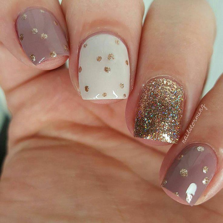 "Dots dots dots - Products used: Middle nail: ""Honeymoon Bliss"" @ellamilapolish Rose gold metal dots: ""Liquid Metal"" Julie G Mauve nude: ""Zoey"" @Klpolish Glitter: ""Juliette"" ILNP over ""Liquid Metal"" Julie G Top coat: Hk girl @glistenandglow1"