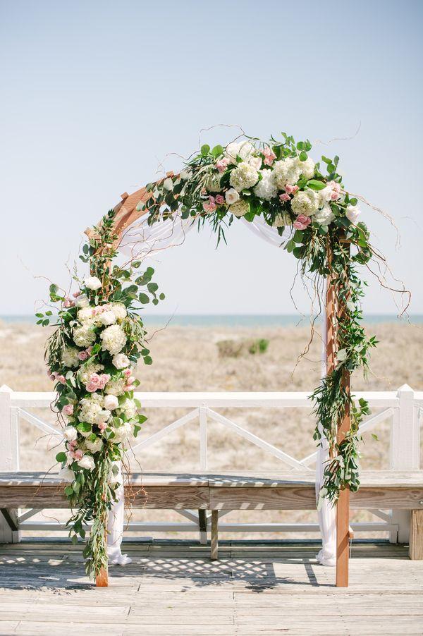gorgeous floral ceremony arch | Britt Croft