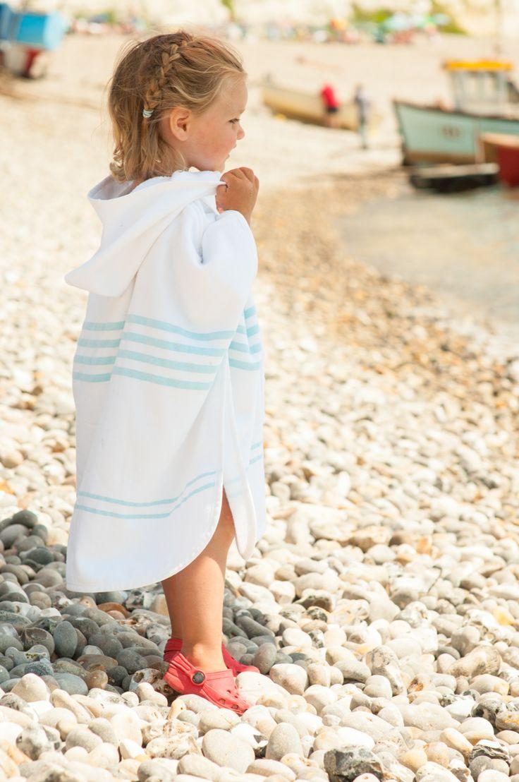 Girl wearing Blue Stripe Hooded Poncho Towel on Beach