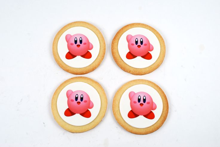 Super cute Kirby cookie en route for a cookie decorating party