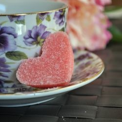 This is good to make on valentines day or tea parties. Very easy to make all you need is sugar, food coloring, ice tray. Would look nice with regular cubes too :) I totes have a mini ice cube tray