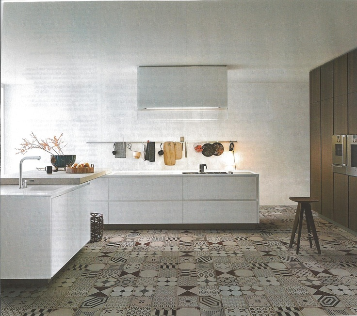Unusual floor for a kitchen this modern, but I like the contrast.  From Eigen huis & Interieur