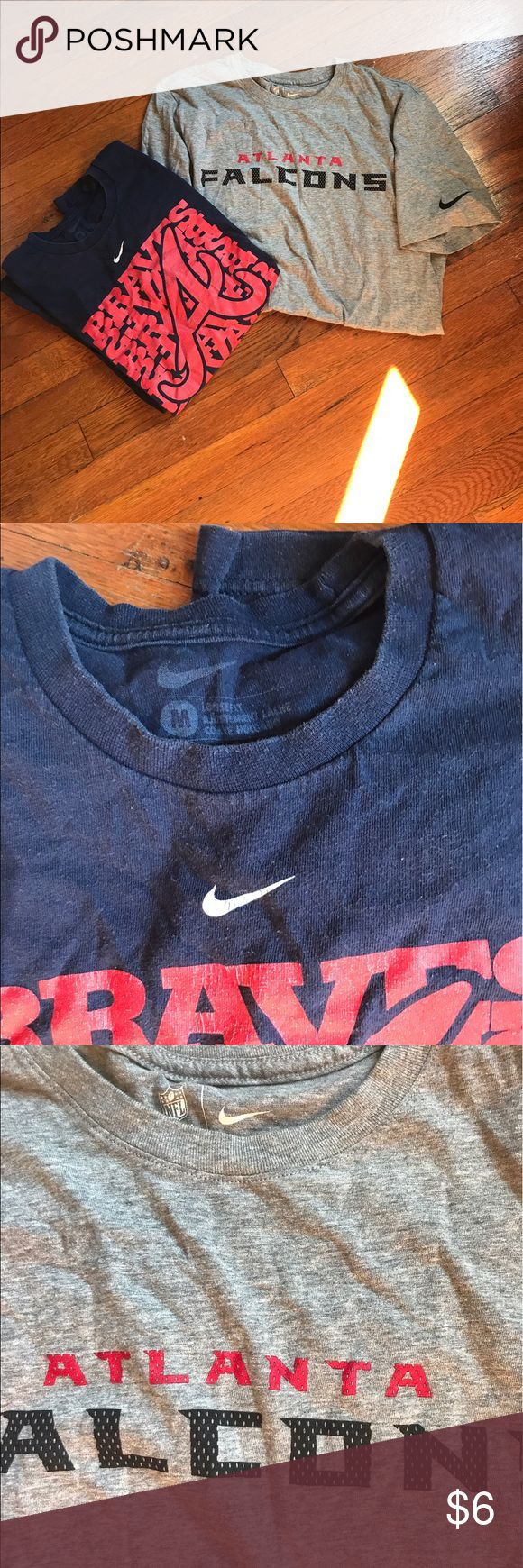 Group of 2 Nike Atlanta Tees: Braves & Falcons Bundle of two Atlanta sports team Nike tees including a gray Atlanta Falcons tee and a navy blue and red Braves tee. Braves baseball shirt size medium and well worn. Less wear to Falcons football shirt, also size medium. Nike Shirts Tees - Short Sleeve
