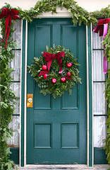 A Christmas Wreath and Garland:   A traditional wreath and garland is one of the best ways to dress up your front door for the holidays. flickr.com/Muffet. What's great about this kind of wreath and garland is that it can be dressed up in any way you choose. Add elegant bows, natural-looking pinecones, festive ornaments, or any other decoration of your choosing. It can be made to look fun, elegant, sophisticated - anything you want!
