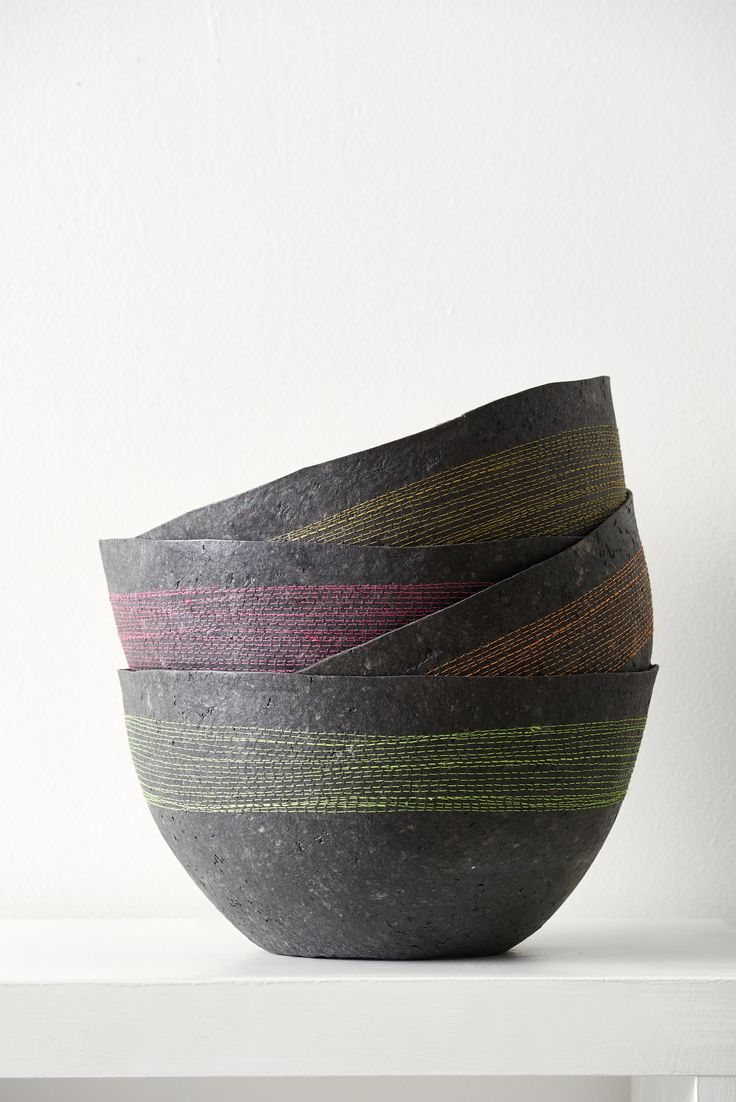 The Quazi Charcoal Bowls were updated this season with bright stitching, adding a pop of color where you'd least expect it.