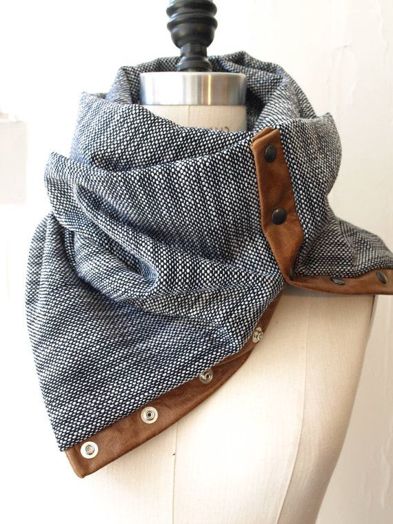 Navy and white circular infinity scarf $60.00 - material : blend of rayon - Circumference : 56 inches - Wide: 25 inches - Brandy leather trim with snap - hand wash - dry flat