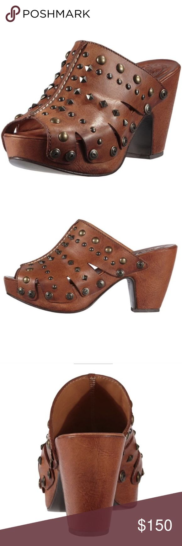 Ariat Tasmania Studded Clog NWB Bohemian-inspired styling and artisan craftsmanship created the individualistic Tasmania clog. This eclectic slip-on clog is constructed from full-grain leather that has been laser cut and adorned with dome and pyramid metal studs. The footbed is leather lined and features Ariats comfort system. The lightweight base features a 1 1/4 inch platform and 3 1/2 inch heel with a natural leather outsole. Finishing details include a leather-wrapped wedge, hand-stained…