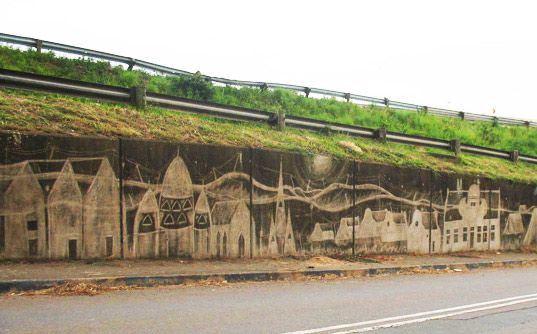 Reverse Graffiti in Durban, South Africa. The drawing is made by scrubbing the wall clean.