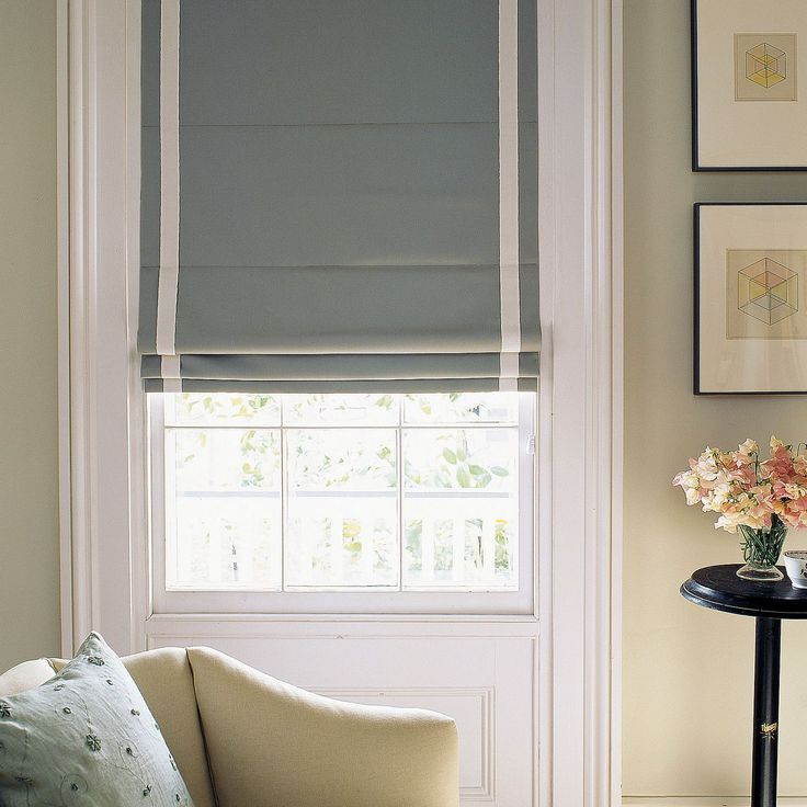 The beauty of this classic Roman shade lies in its simplicity: a single length of finished cloth fit with a system of cords.