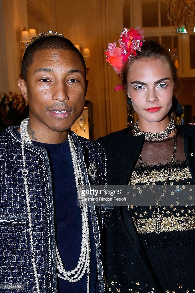 Pharrell Williams and Cara Delevingne attend the 'Chanel Collection des Metiers d'Art 2016/17 : Paris Cosmopolite'