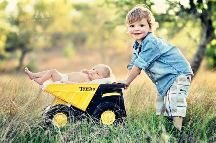 Baby and brother- truck. See Hayley it this is what I was talking about today with the dump truck