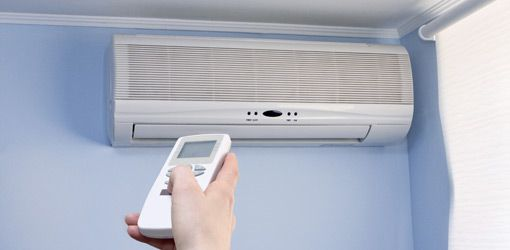Wall Hung AC Units | Wall mounted air conditioner unit with remote control.