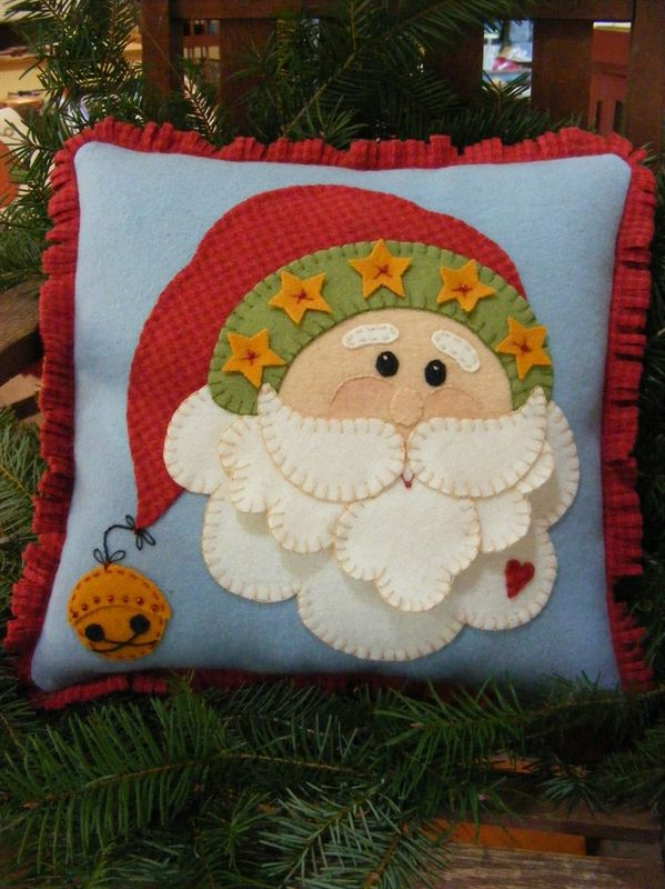 Bird Brain Designs - embroidery, redwork designs, redwork patterns, wool, penny rug, kits, patterns, needlework supplies. A jolly Wool Applique Santa With a Clever Dimensional Beard.