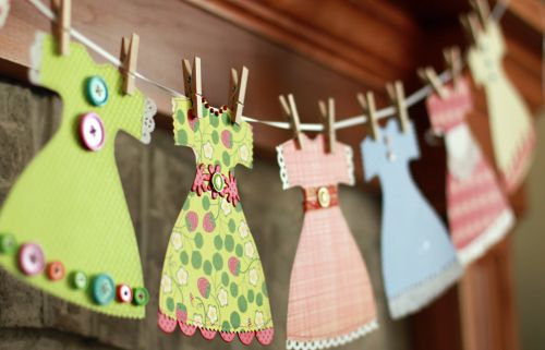 Dress Garland by Trish Turay        My sweet niece is approaching a big milestone–her 2nd birthday is  around the corner. I wanted to do something special for her bedroom  that was girlie and sweet. As a bonus, this garland will be part of her  birthday party decor on the firepla