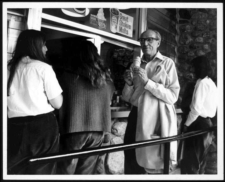 Aaron Copland eating an ice cream cone.
