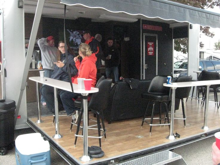 I need to get me one of these tailgate trailers. The only way to go! Couch, bar tables, bar, keg cooler, big screen TV and stereo. Illinois vs Ohio State Fall 2010