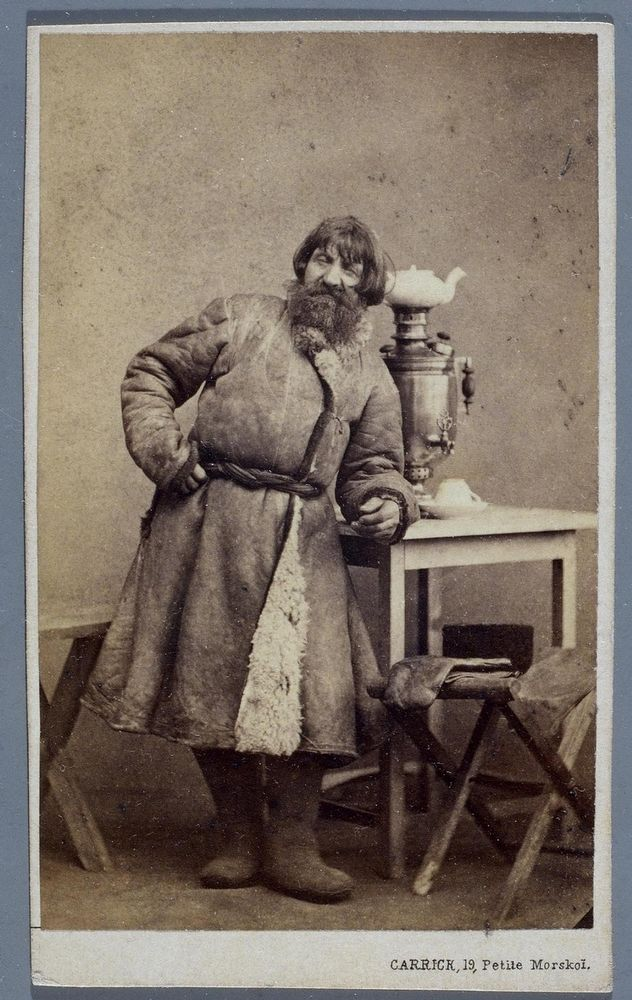 Russian people on photo from 19th centuryAnother cabman, went inside to get some hot tea from the Samovar on the table. Just look at how thick his coat is to withstand all this cold while driving the cab.