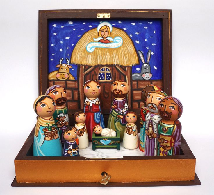 It's the nativity set featuring the Holy Family with two little angels, the Three Kings and the shepherd family. The wooden book was stained, and then hand painted with non-toxic acrylic paints. The f