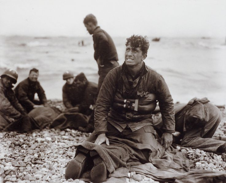 American soldiers on Omaha Beach recover the dead after D-Day 1944 by Walter Rosenblum