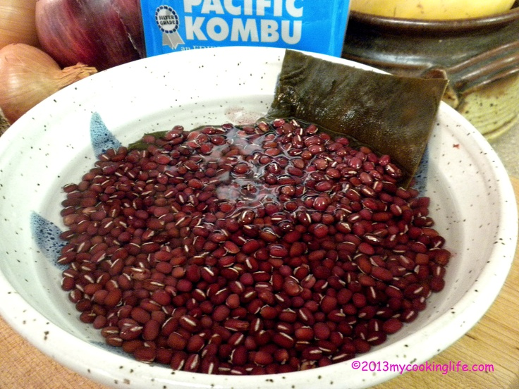 These are aduki (sometimes spelled azuki) beans. They are soaking in spring water with kombu.